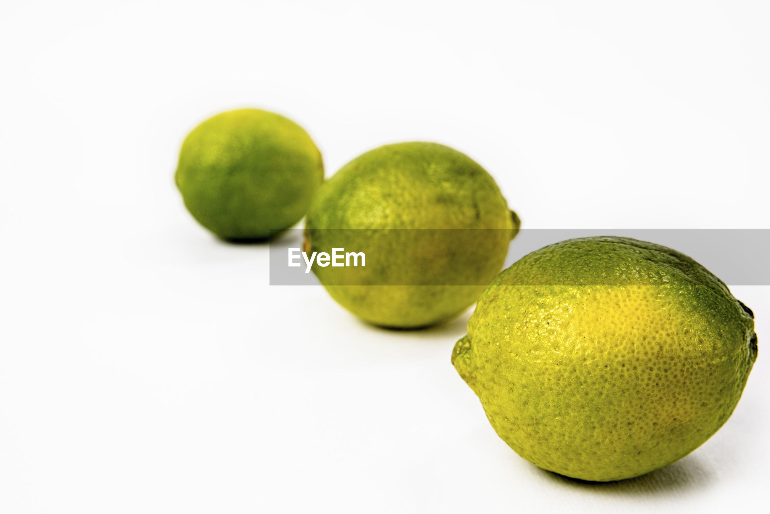 CLOSE-UP OF GREEN FRUITS