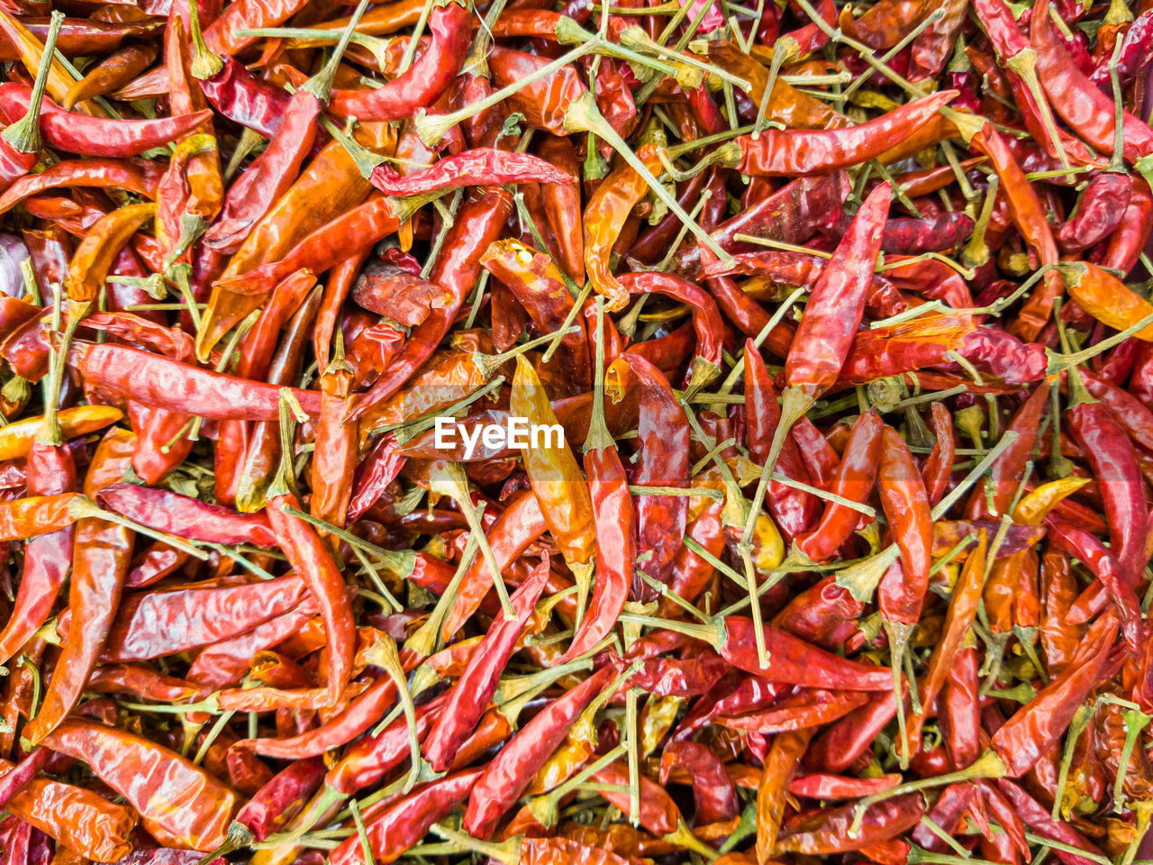 Top view of a pile of dried peppers, red chili that are spicy flavour and used for cooking.