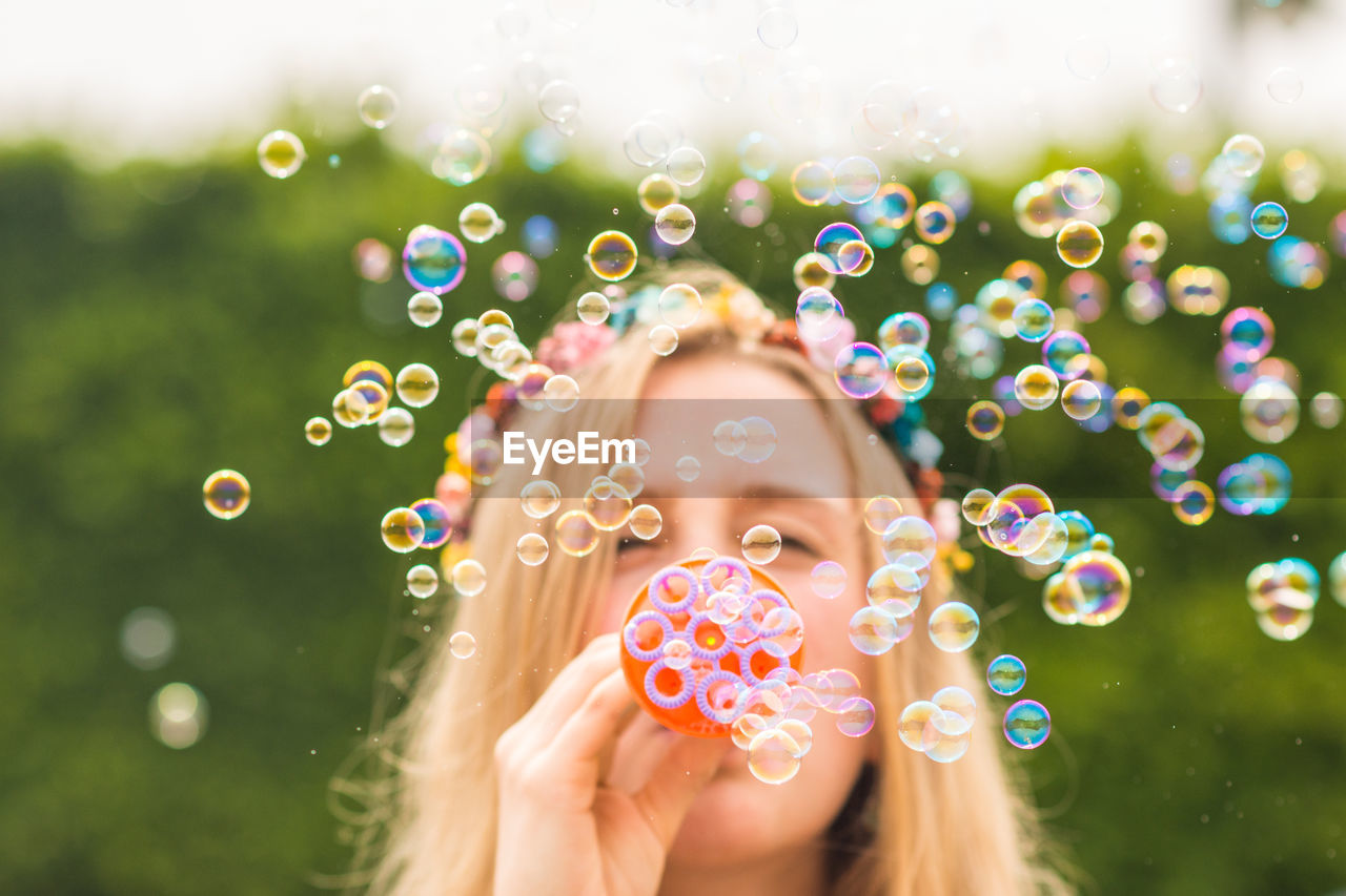 Portrait Of Beautiful Woman With Bubbles