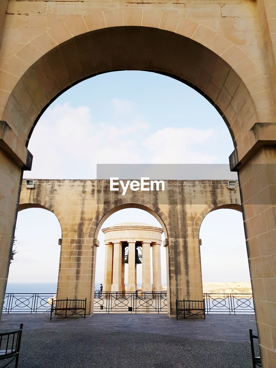 arch, architecture, built structure, sky, nature, day, history, cloud - sky, no people, the past, architectural column, low angle view, building exterior, direction, travel, outdoors, travel destinations, the way forward, tourism, arched, colonnade