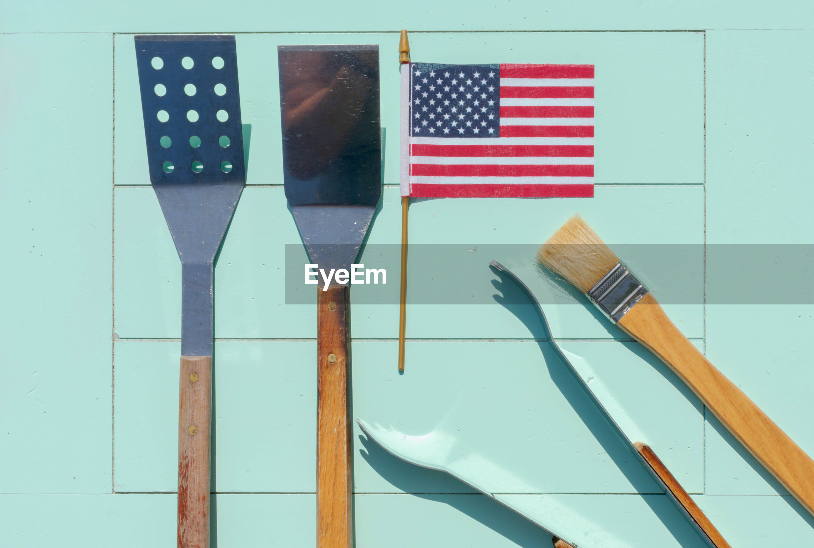 Directly above shot of cooking utensils with american flag on table