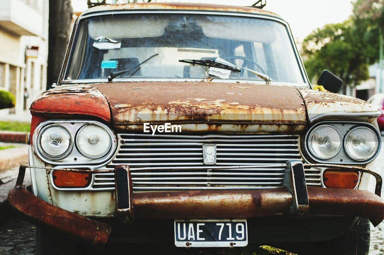 mode of transport, transportation, headlight, car, land vehicle, rusty, vintage car, retro styled, abandoned, damaged, obsolete, old-fashioned, day, weathered, no people, outdoors, stationary, close-up