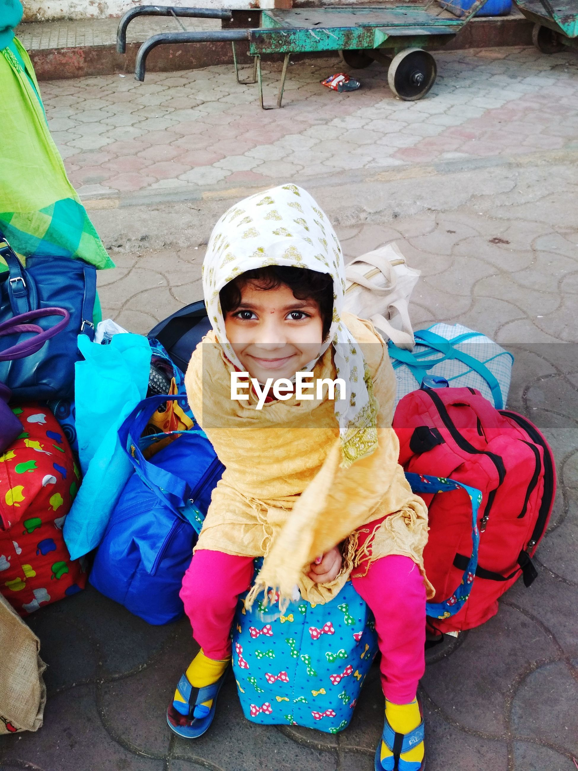 Indian child - traveling in winter season.