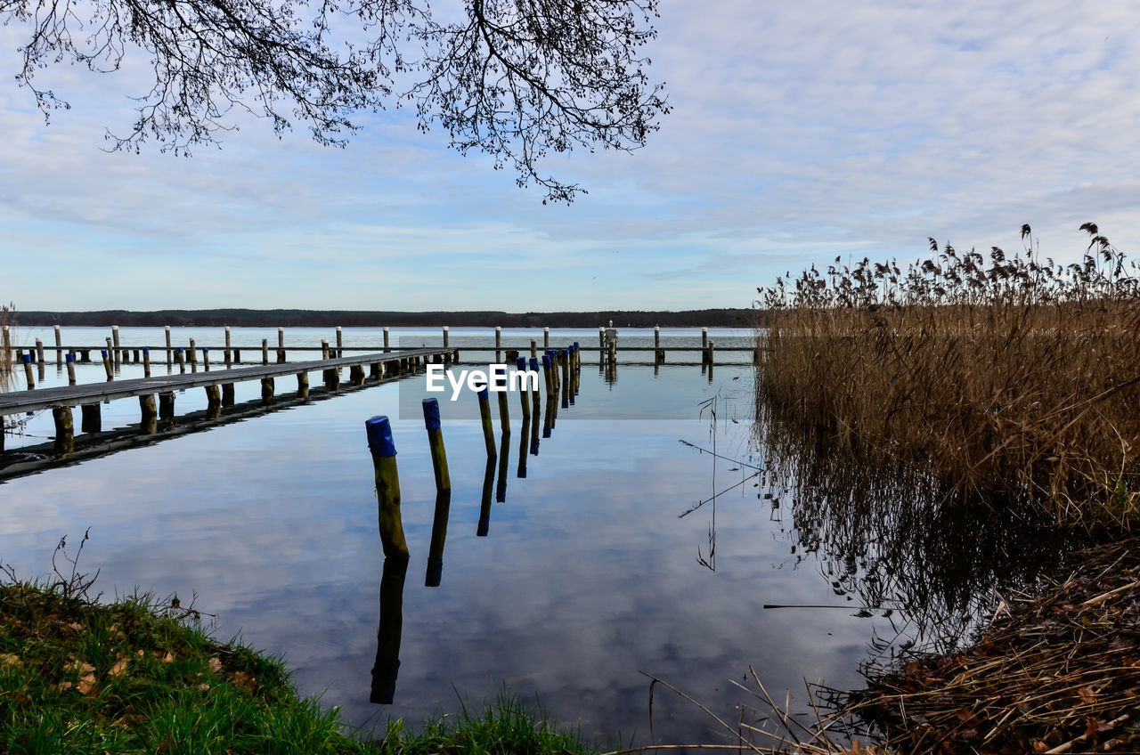 water, nature, sky, growth, outdoors, lake, tranquil scene, cloud - sky, tranquility, beauty in nature, plant, reflection, no people, tree, day, grass, scenics