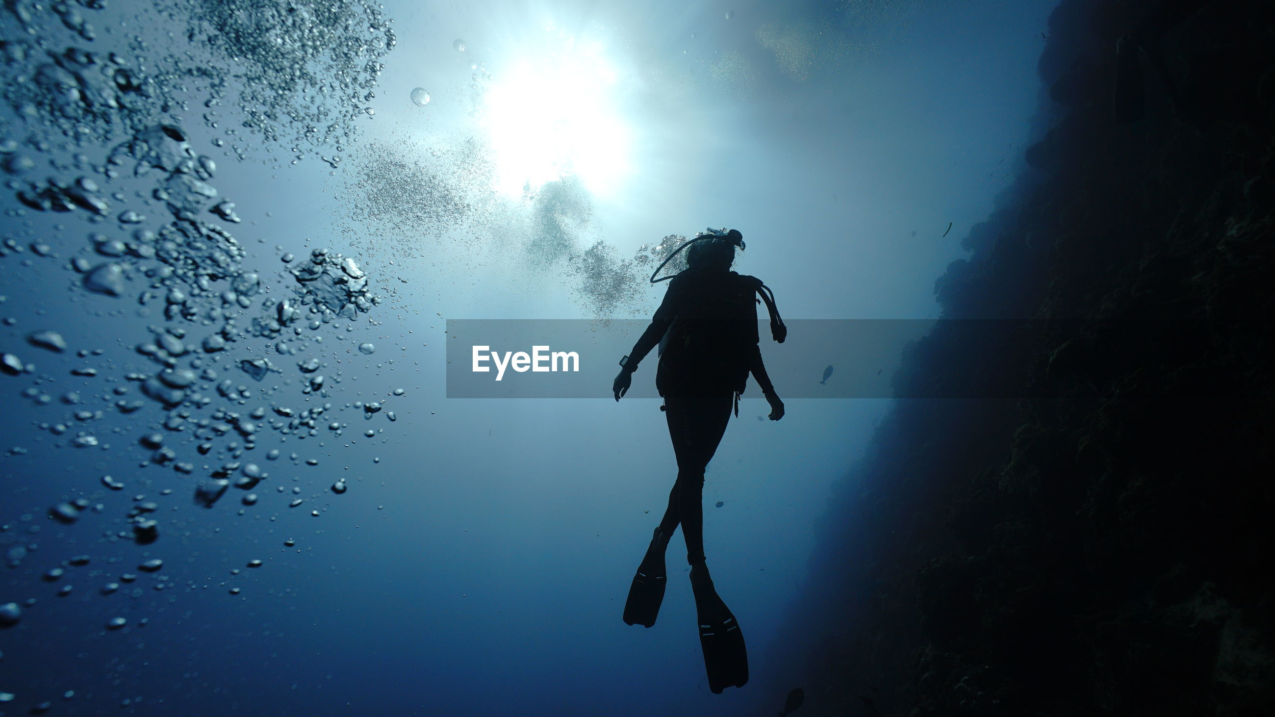 Low angle view of man in sea against sky