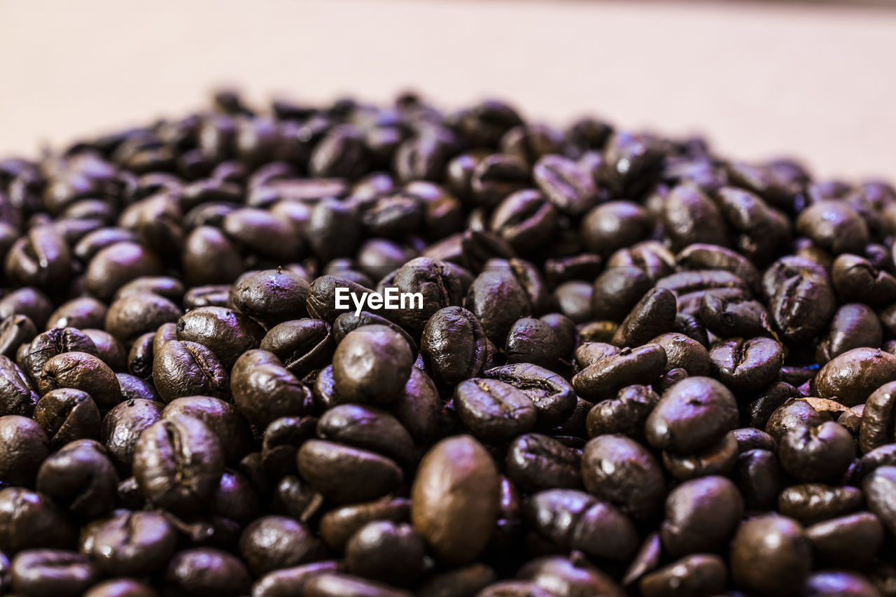 food and drink, food, freshness, selective focus, large group of objects, purple, close-up, still life, healthy eating, no people, indoors, wellbeing, abundance, raw food, heap, coffee, backgrounds, roasted coffee bean, ingredient, coffee - drink, temptation