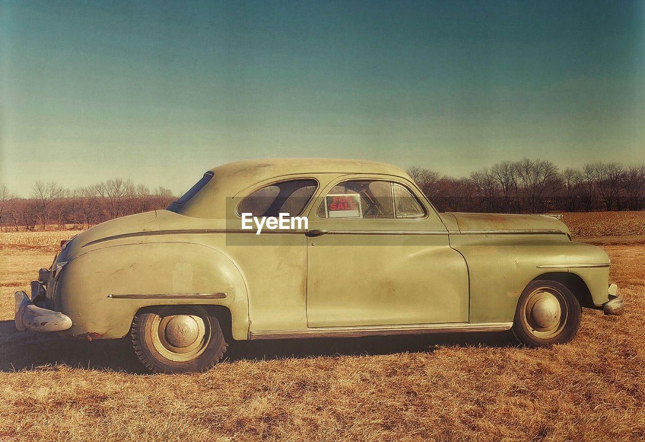 Vintage car on field for sale