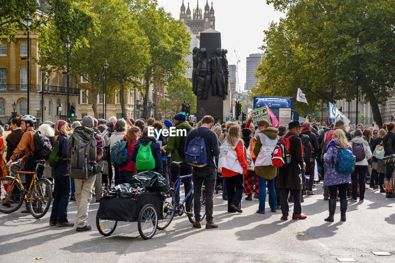 GROUP OF PEOPLE ON STREET