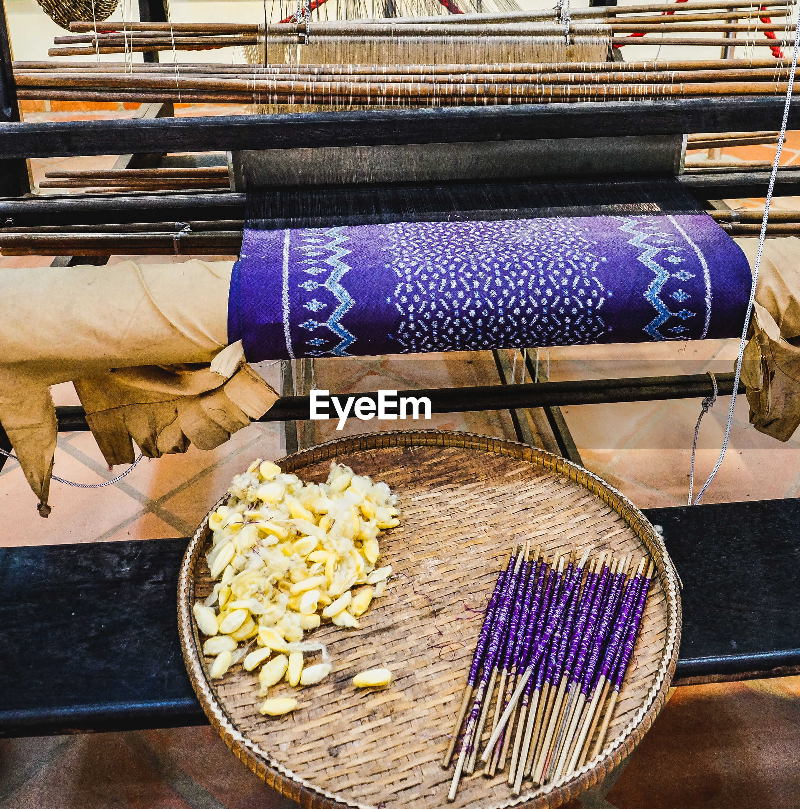 High angle view of silk weaving in factory