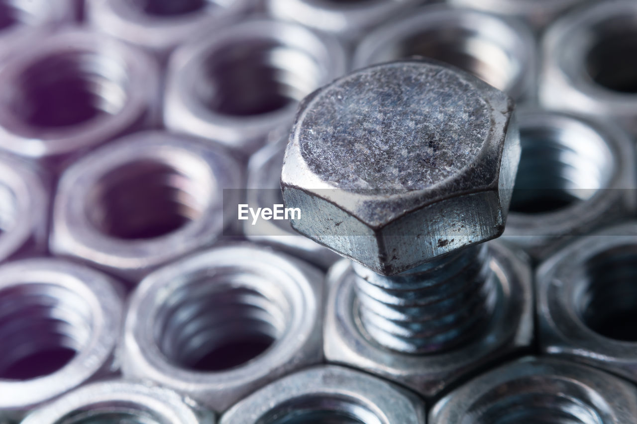 Close-up of screw in nut