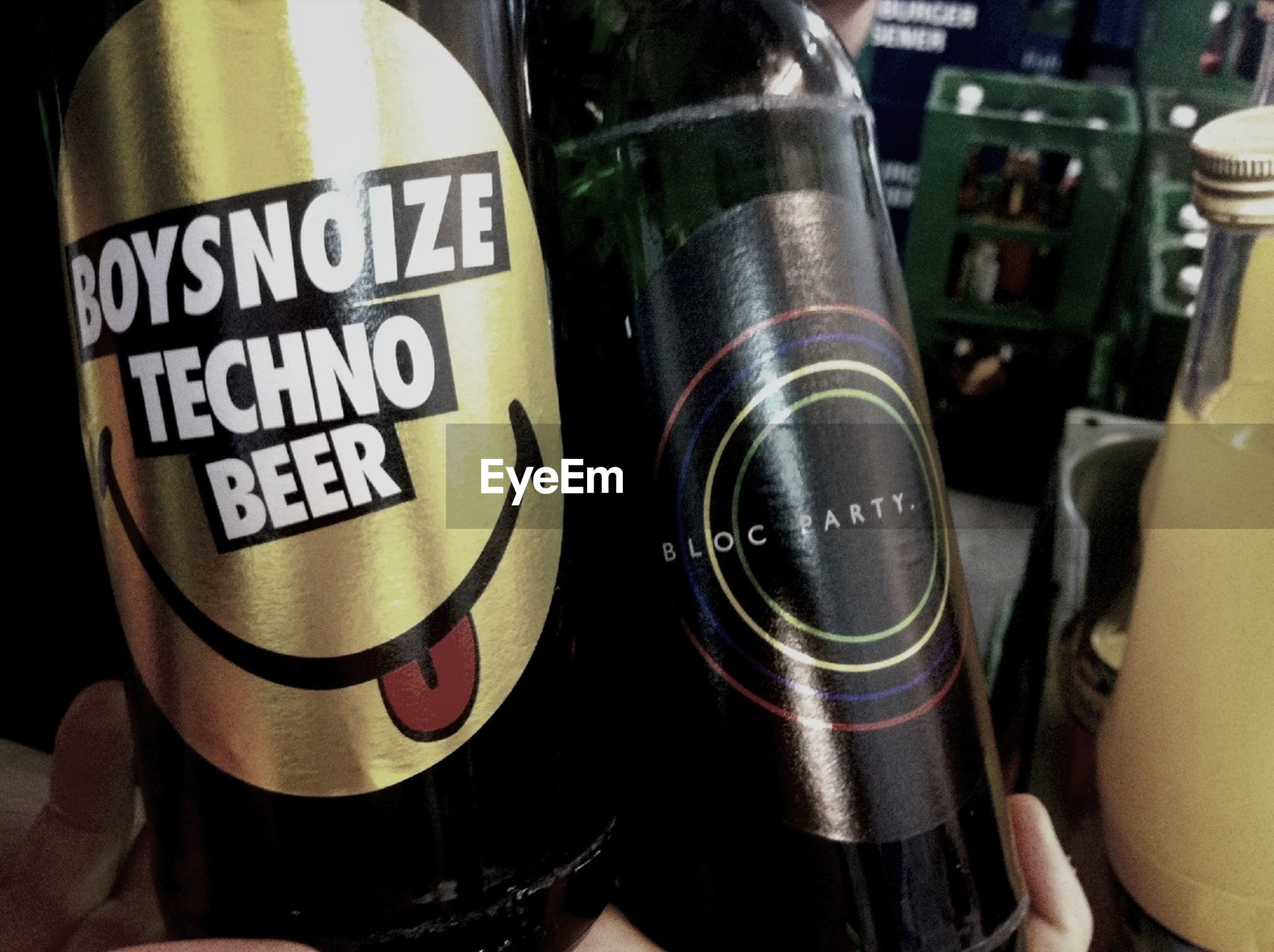 indoors, text, communication, close-up, western script, drink, food and drink, refreshment, number, technology, focus on foreground, part of, alcohol, bottle, glass - material, high angle view, men