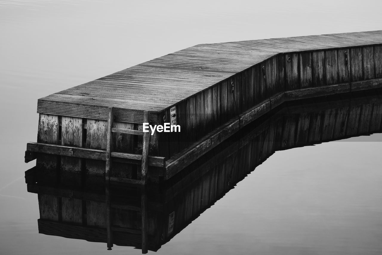 architecture, built structure, water, sky, no people, nature, day, clear sky, building exterior, wood - material, waterfront, building, outdoors, connection, lake, reflection, low angle view, roof, bridge