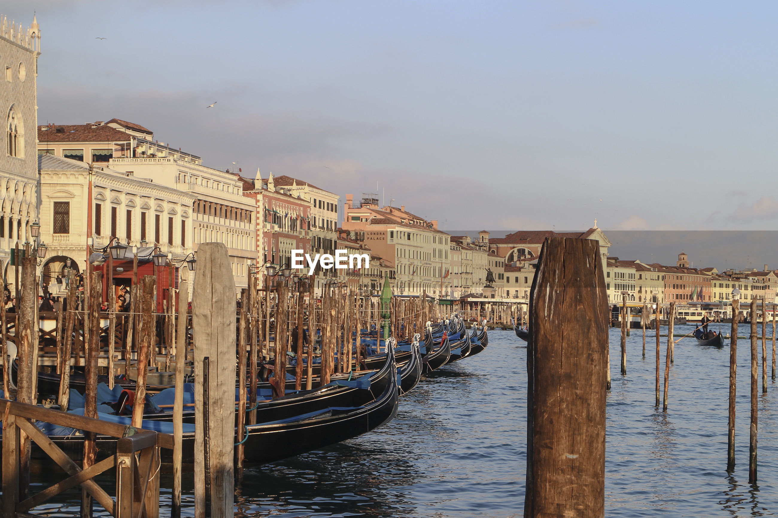 view of gondolas moored in venice