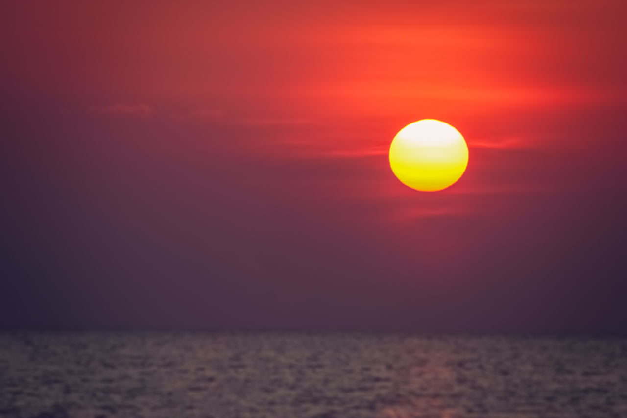 sunset, sun, sky, beauty in nature, orange color, tranquility, scenics - nature, nature, horizon over water, tranquil scene, sea, cloud - sky, idyllic, water, sunlight, horizon, no people, circle, outdoors, eclipse