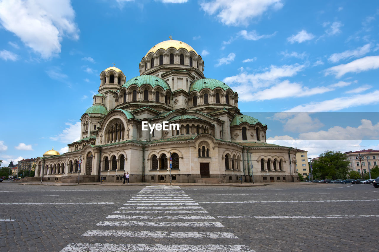 building exterior, architecture, sky, built structure, cloud - sky, history, nature, building, religion, place of worship, travel destinations, the past, day, belief, spirituality, city, travel, dome, incidental people, outdoors