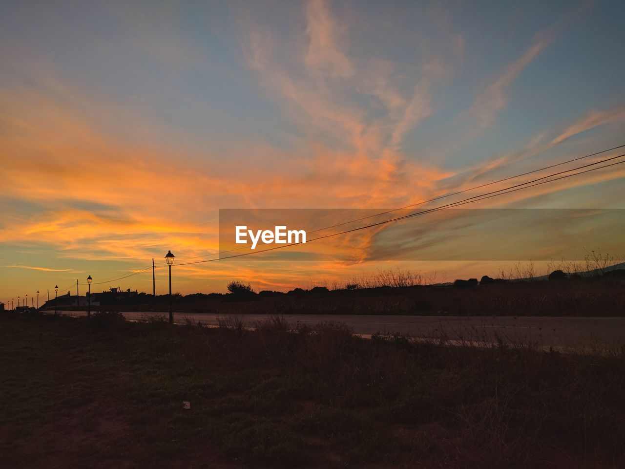sunset, sky, cloud - sky, no people, nature, field, tranquil scene, beauty in nature, landscape, tranquility, scenics, outdoors, water, day
