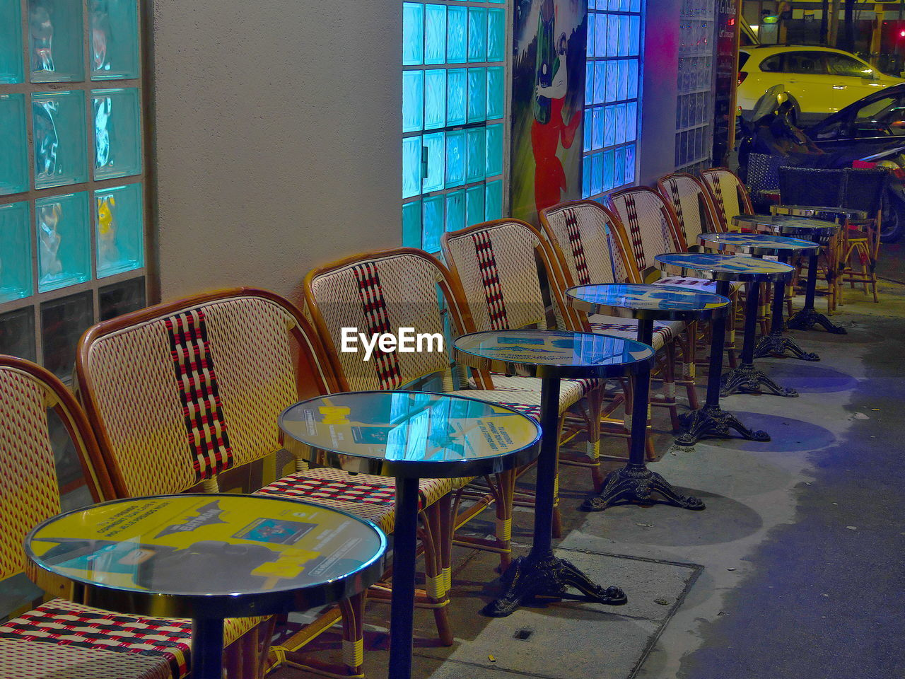 EMPTY CHAIRS AND TABLE IN STADIUM
