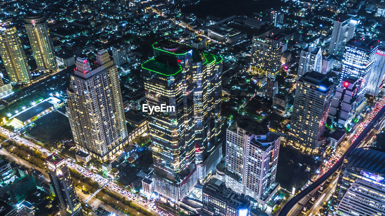 architecture, night, illuminated, building exterior, city, skyscraper, cityscape, modern, high angle view, built structure, aerial view, travel destinations, outdoors, no people, urban skyline