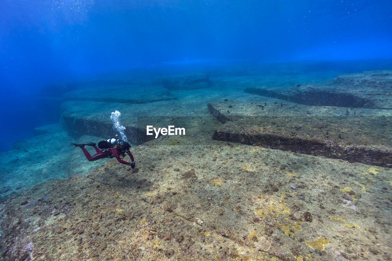 Person scuba diving at yonaguni island
