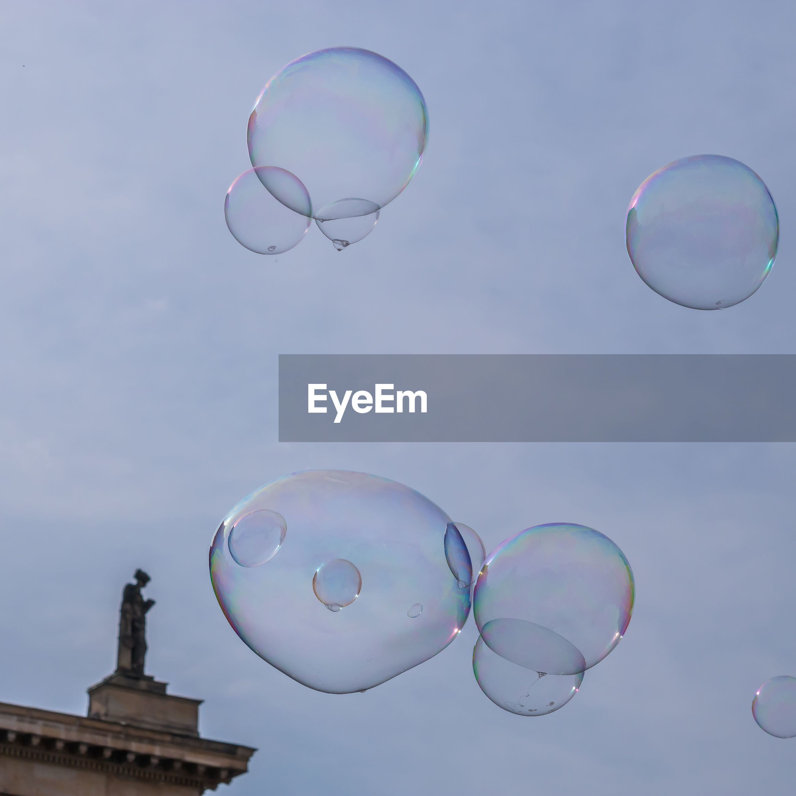 Low angle view of bubbles against sky