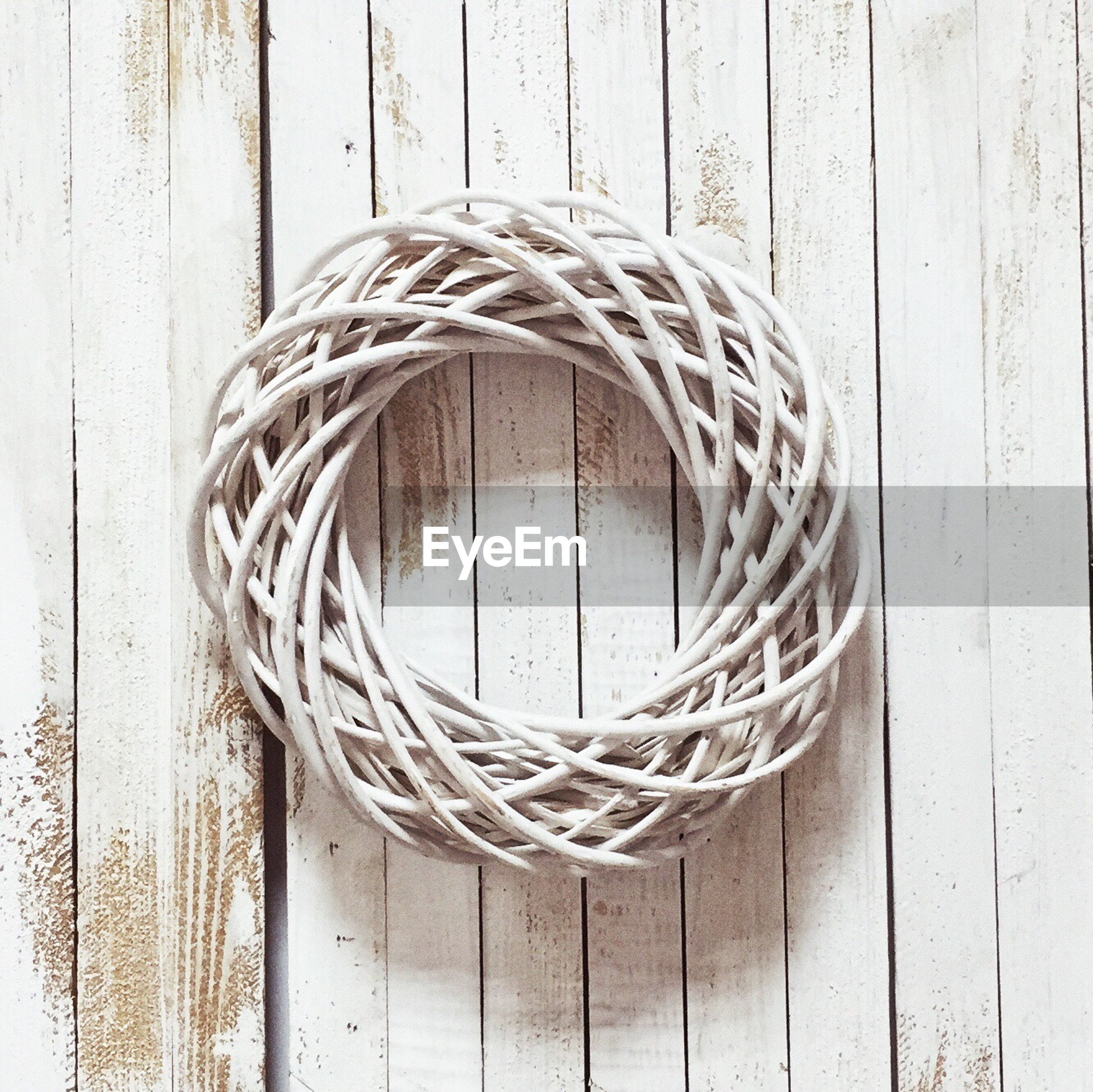 Directly above shot of wicker wreath on wooden table