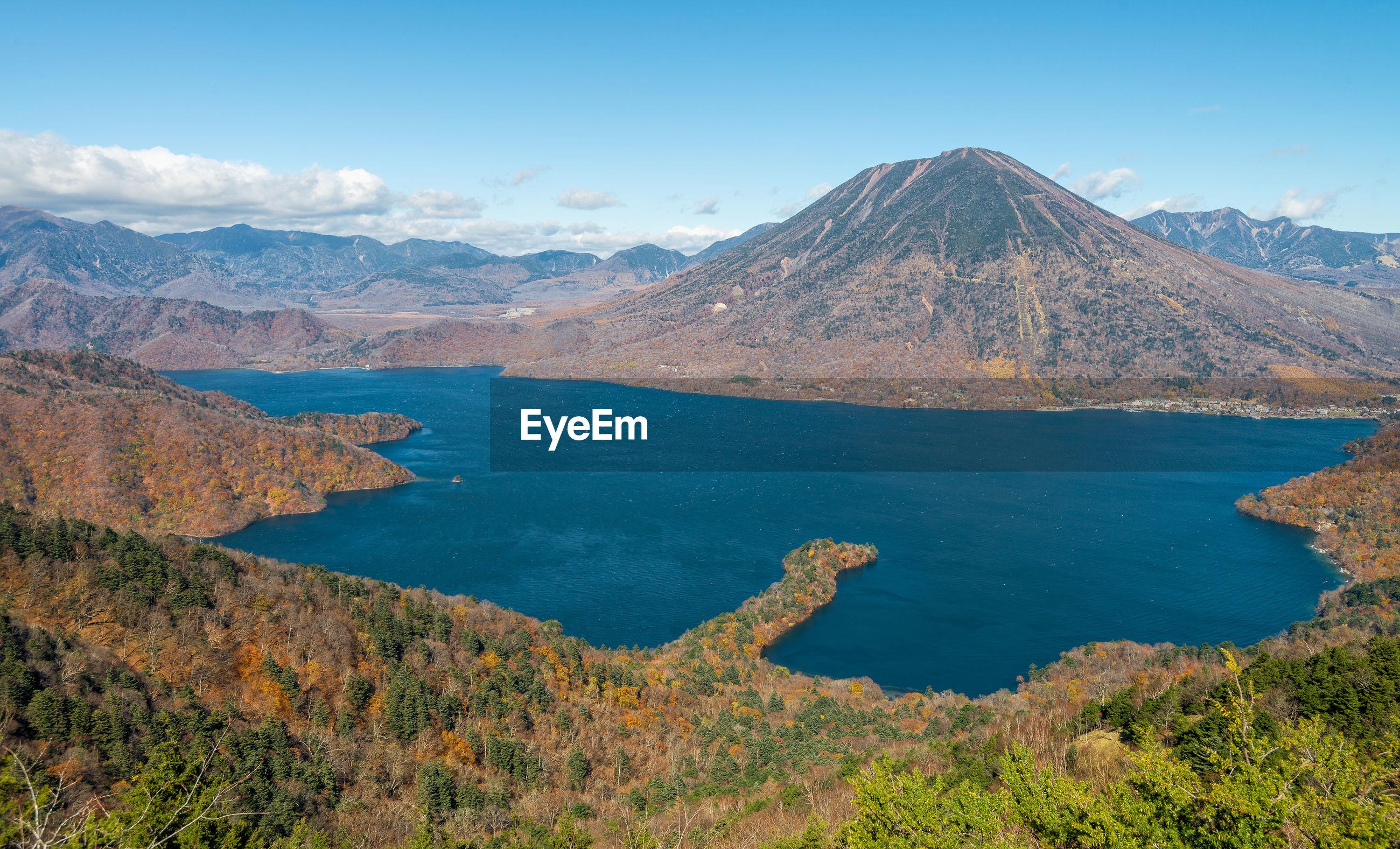Panoramic view of lake chuzenji and nantai mountain in autumn season.