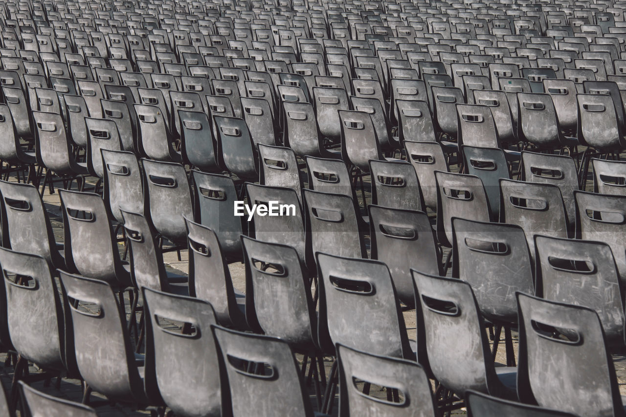 Full frame of empty chairs in square