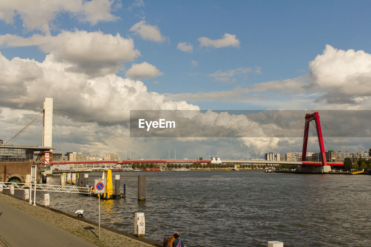 cloud - sky, water, sky, built structure, architecture, transportation, bridge, industry, waterfront, bridge - man made structure, nature, building exterior, river, connection, day, engineering, travel, outdoors, pier, construction equipment