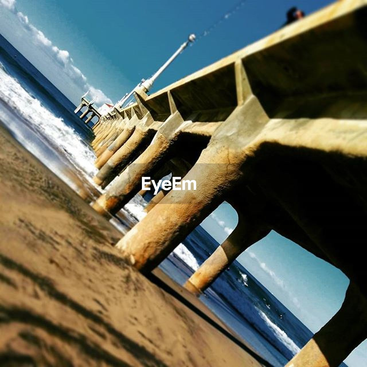wood - material, no people, day, nautical vessel, water, sky, sunlight, outdoors, built structure, architecture, low angle view, sea, nature, building exterior, close-up