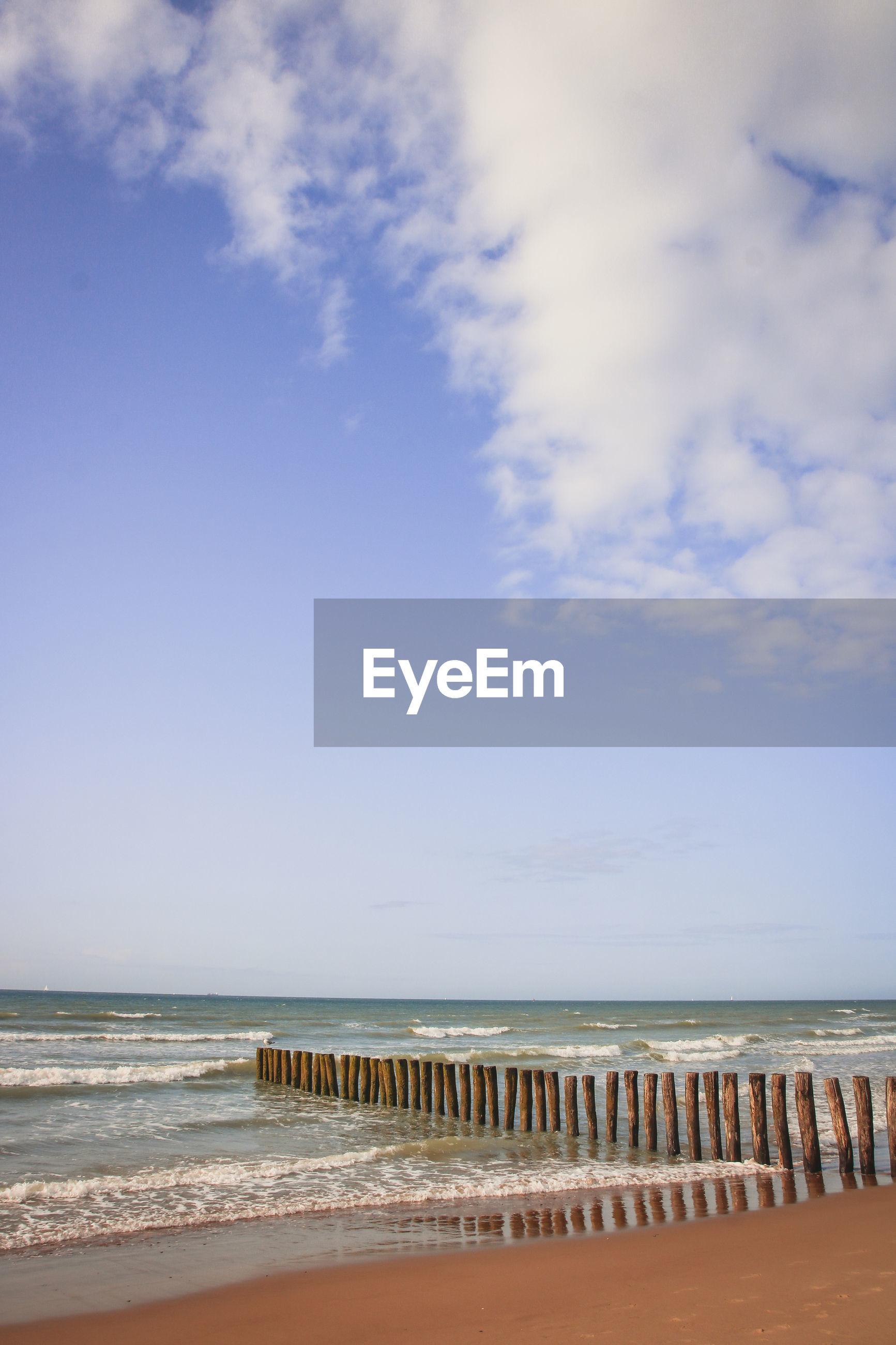 GROYNE ON BEACH AGAINST SKY