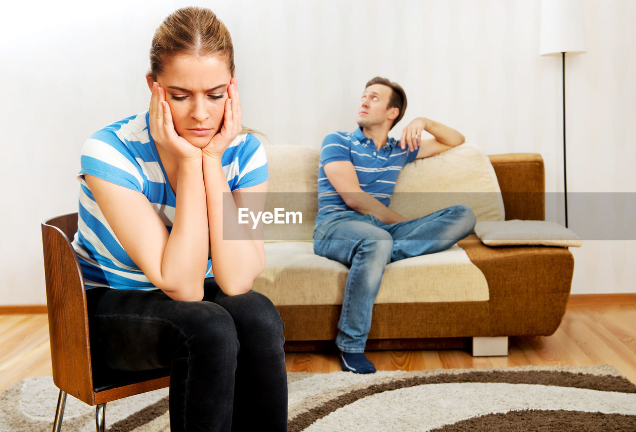 Tensed Couple Sitting At Home