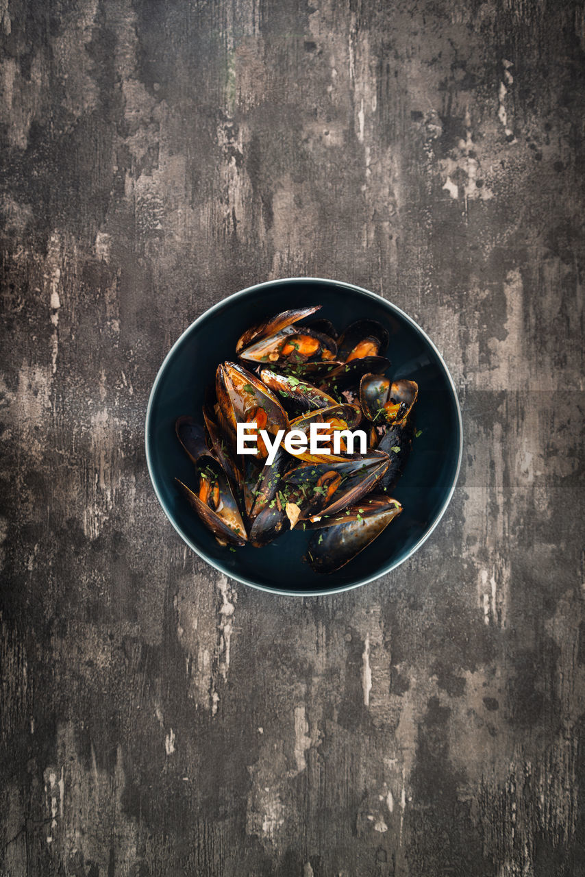 Directly above shot of shellfish in bowl on table