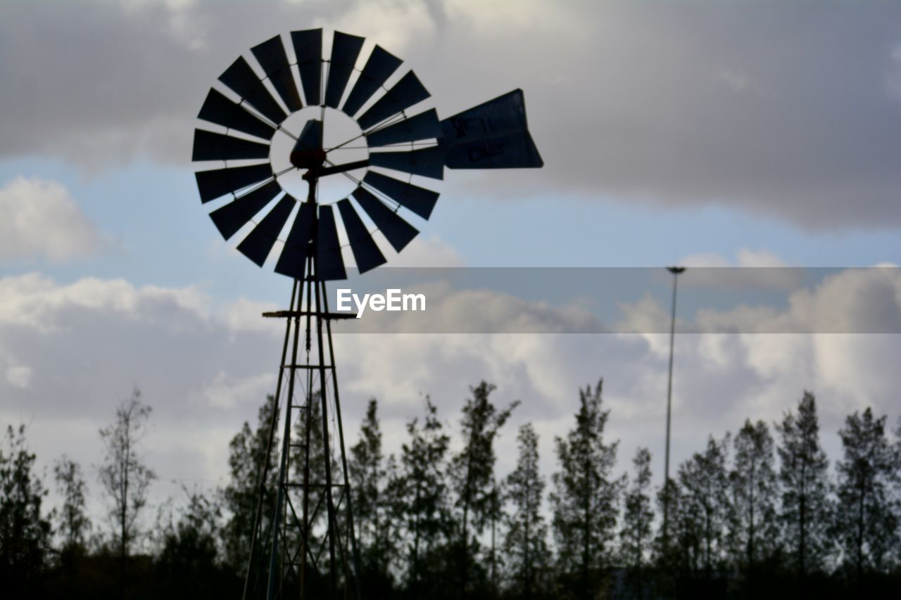 renewable energy, alternative energy, wind power, wind turbine, windmill, environmental conservation, fuel and power generation, cloud - sky, sky, low angle view, tree, traditional windmill, outdoors, no people, day, industrial windmill, nature, rural scene