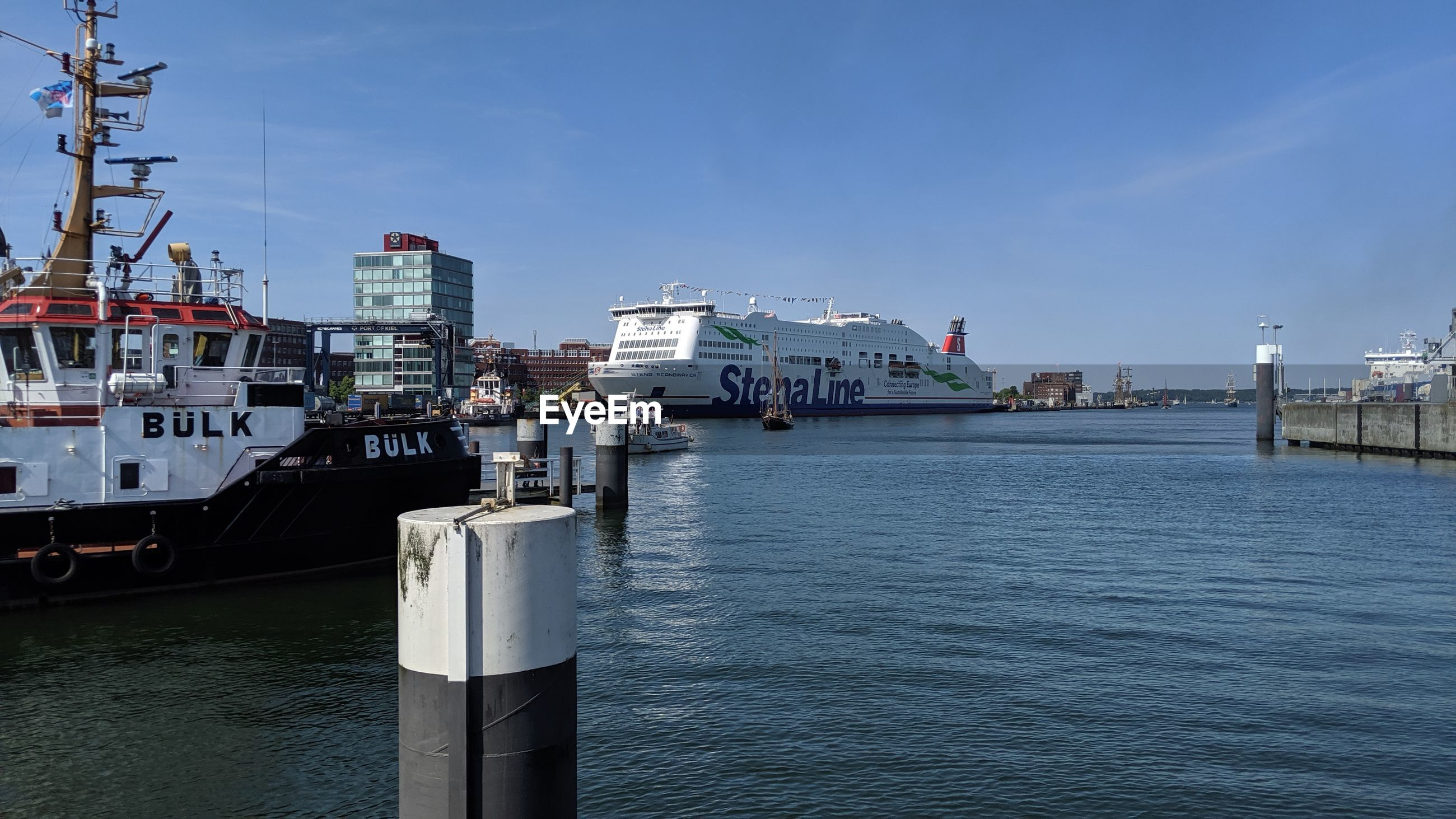 VIEW OF SHIP IN HARBOR AGAINST SKY