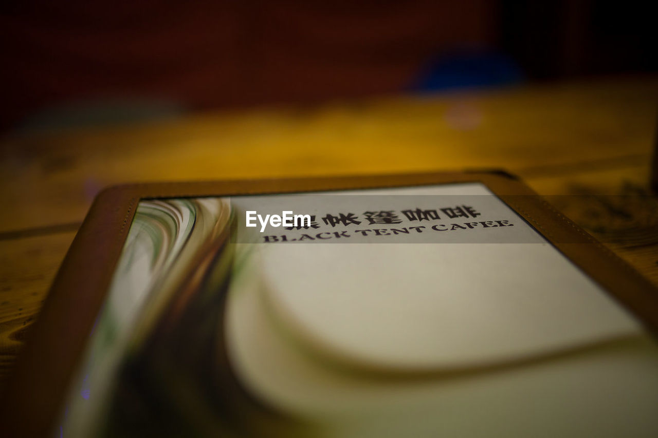 text, indoors, communication, table, no people, paper, close-up, day