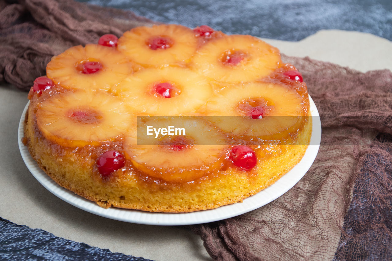 food, food and drink, freshness, sweet food, sweet, dessert, fruit, ready-to-eat, healthy eating, close-up, indulgence, still life, baked, temptation, table, cake, high angle view, no people, indoors, yellow, tart - dessert, fruitcake