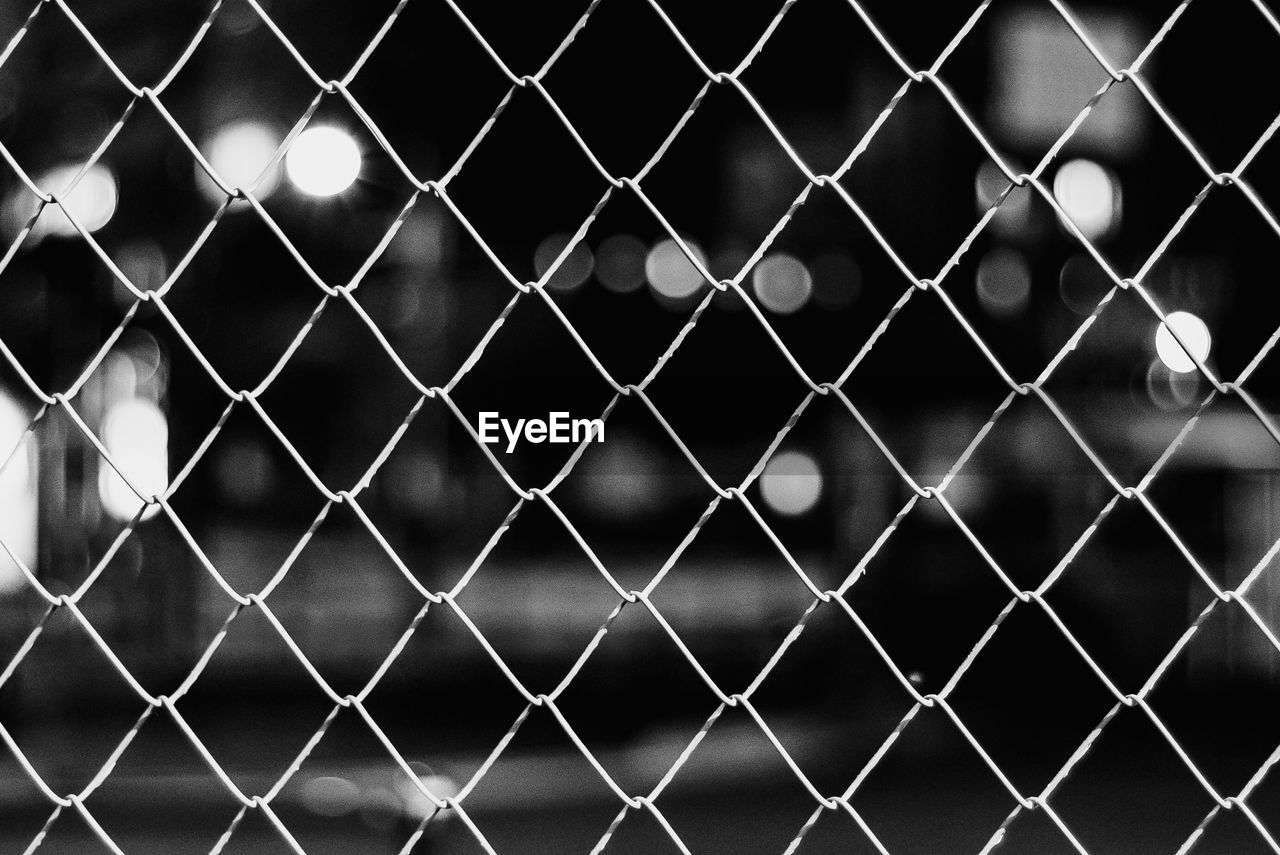 fence, chainlink fence, barrier, boundary, pattern, protection, safety, security, no people, full frame, backgrounds, metal, focus on foreground, close-up, day, nature, outdoors, shape, sunlight