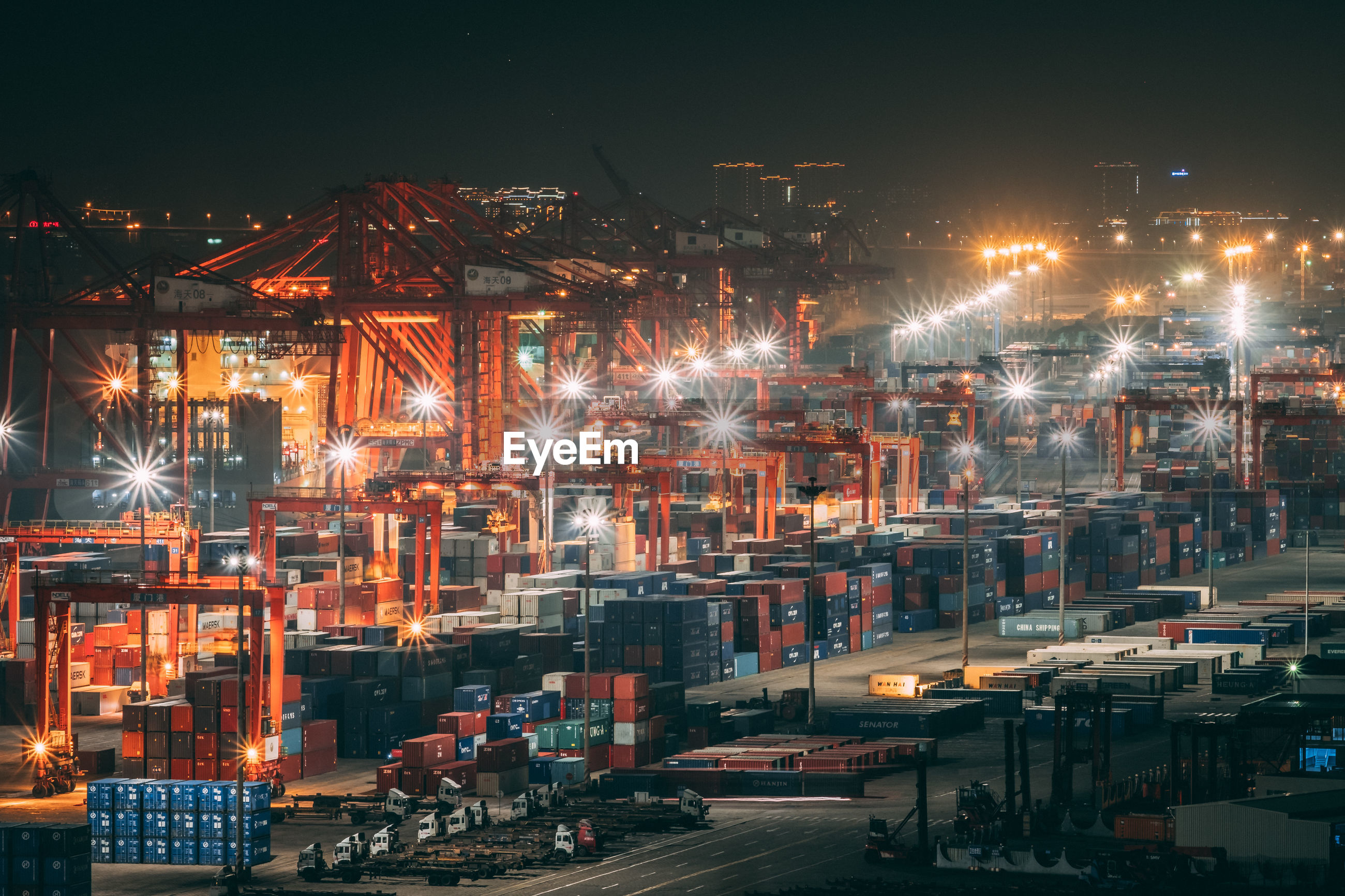 Cargo containers at commercial dock at night