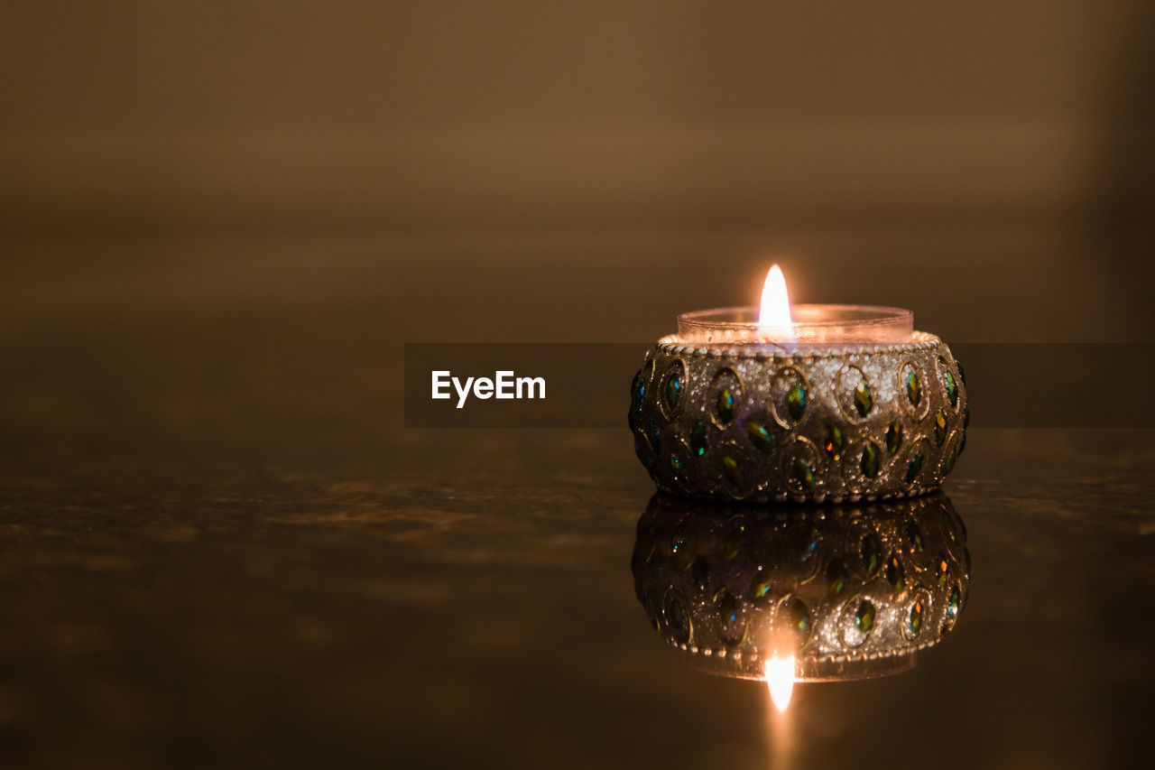 Close-Up Of Illuminated Diya