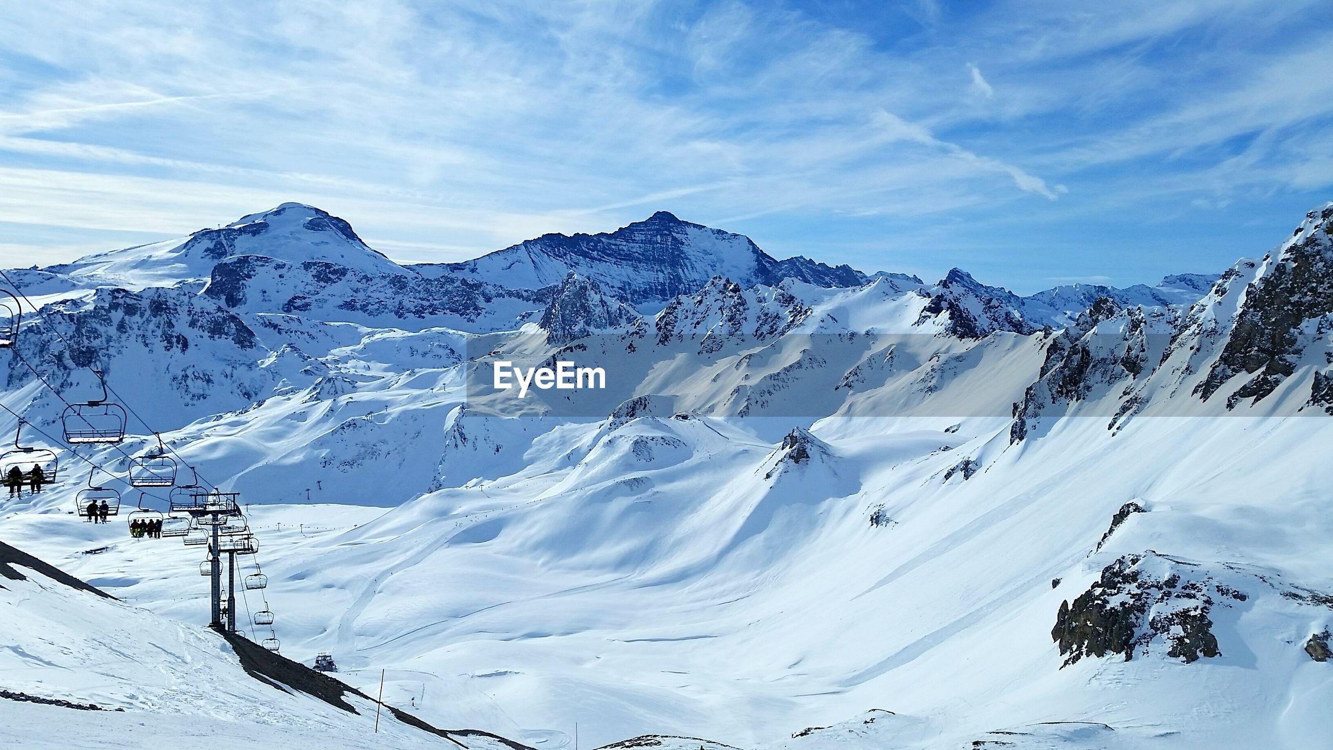 Ski resort against cloudy sky