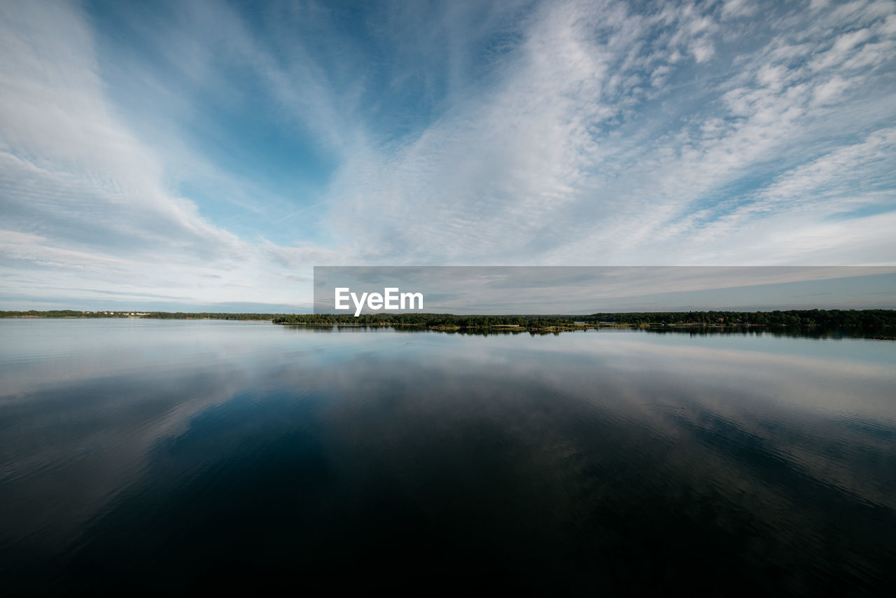 sky, cloud - sky, water, tranquility, scenics - nature, beauty in nature, tranquil scene, reflection, nature, waterfront, no people, idyllic, lake, blue, non-urban scene, day, outdoors, remote
