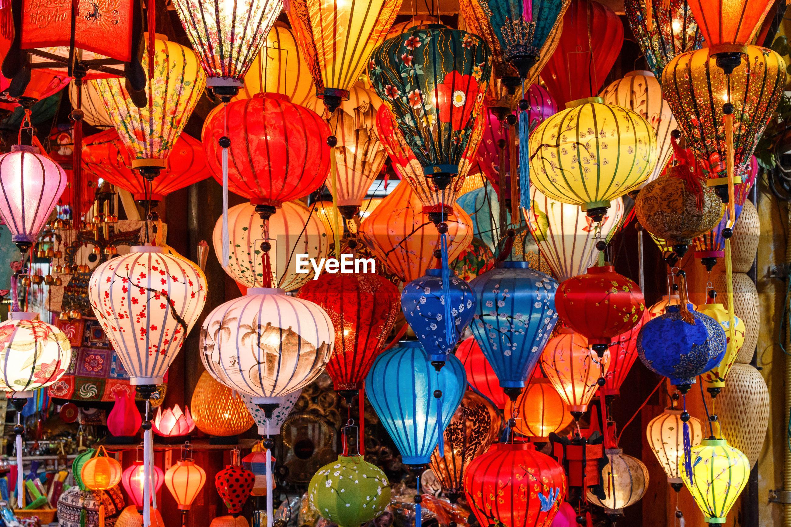 Full frame shot of multi colored lanterns hanging at market