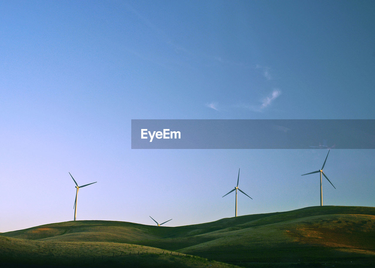 wind turbine, renewable energy, alternative energy, environment, turbine, environmental conservation, sky, wind power, fuel and power generation, landscape, blue, nature, beauty in nature, field, scenics - nature, no people, tranquility, land, day, rural scene, sustainable resources