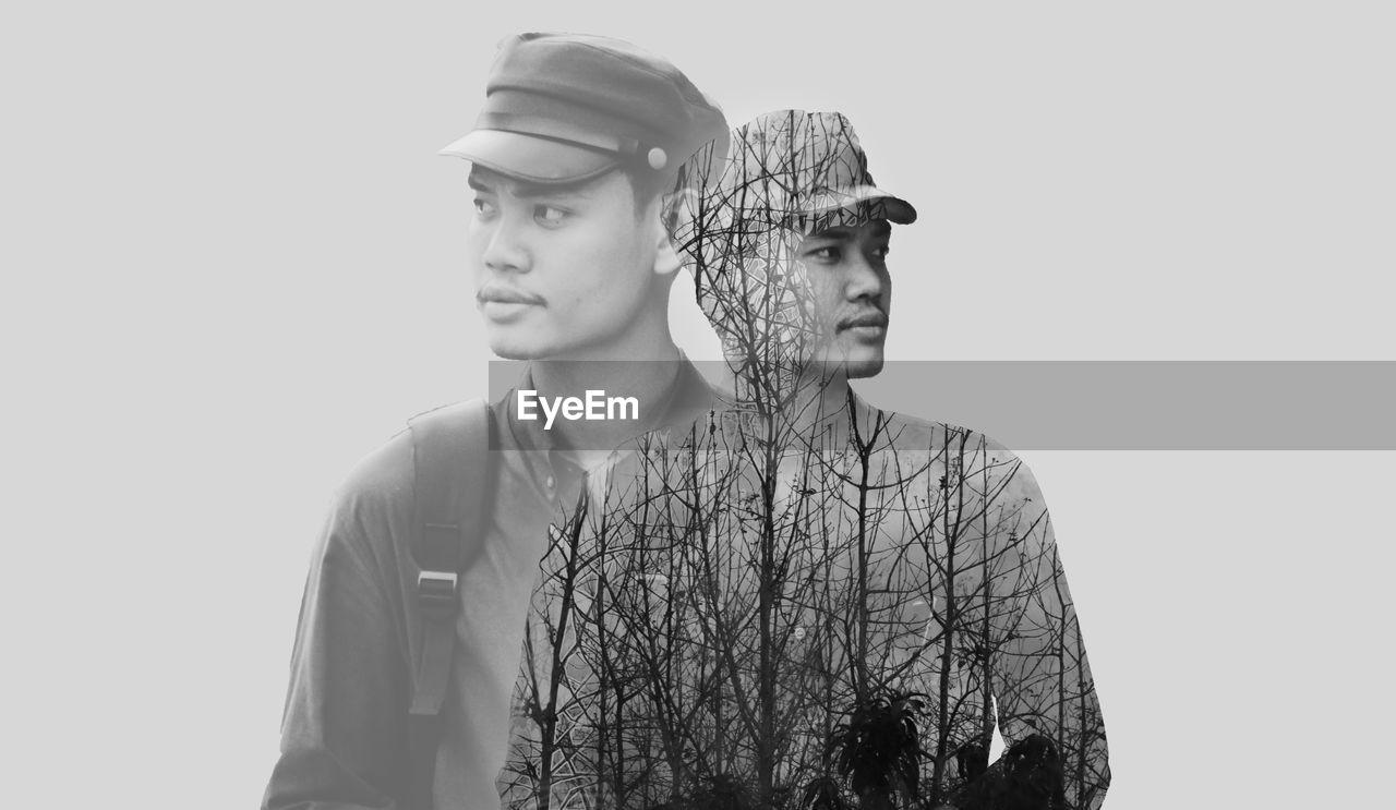 Multiple exposure of man looking away against gray background