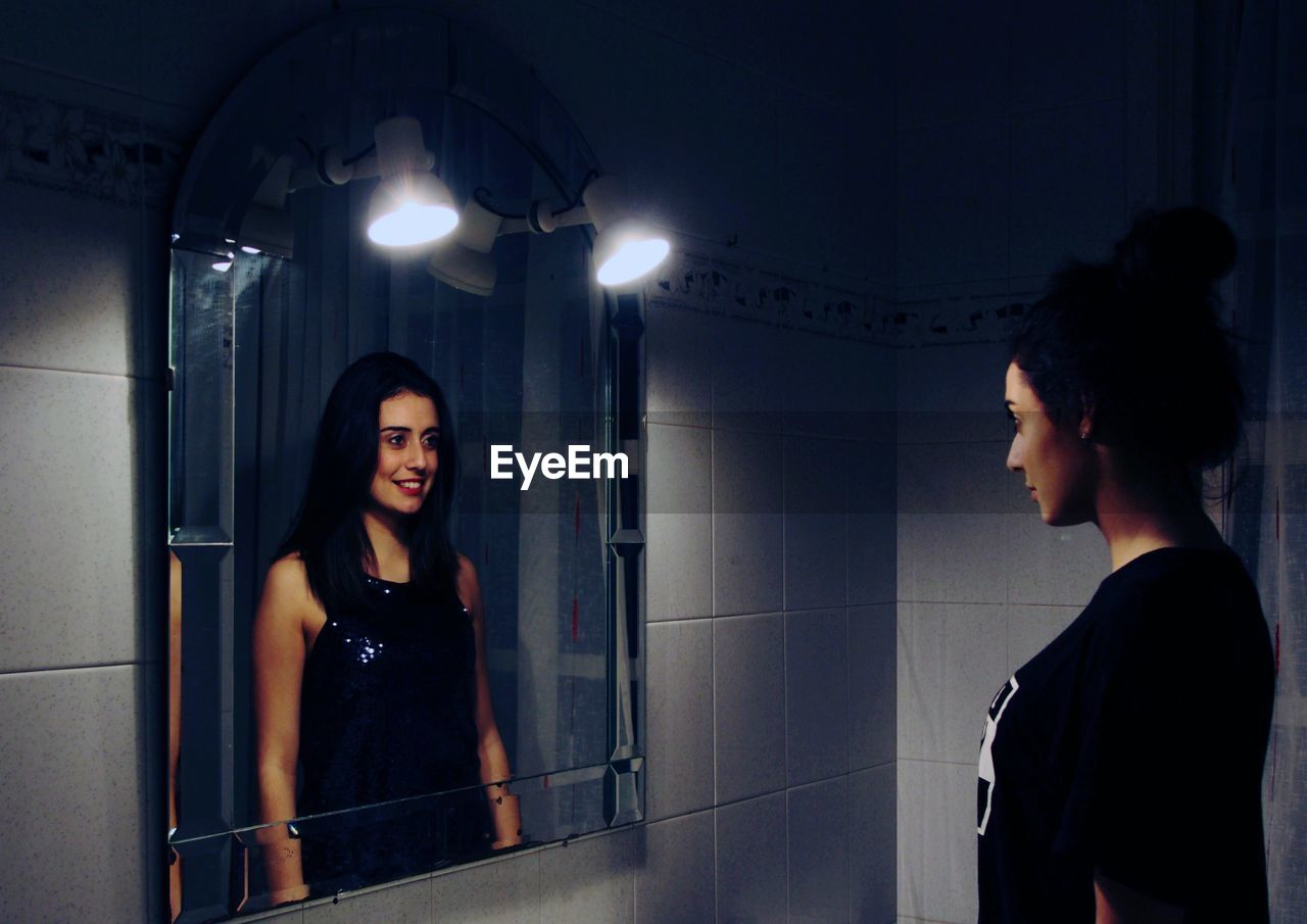 Multiple Image Of Woman Reflecting On Mirror