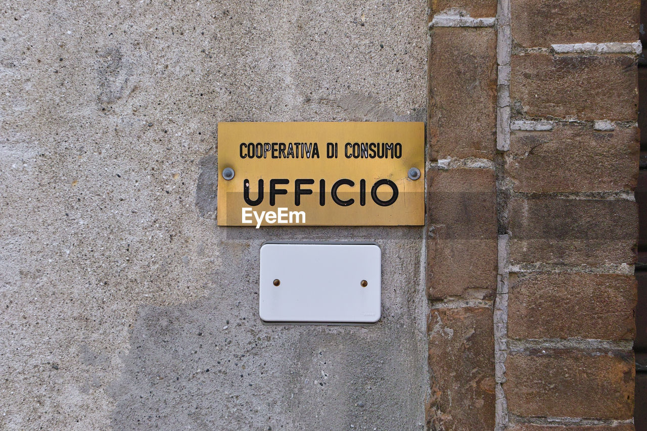 CLOSE-UP OF YELLOW TEXT ON WALL