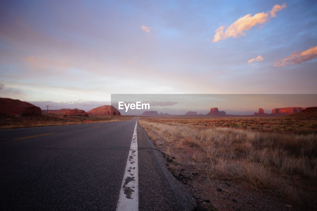 Empty Road Along Monument Valley