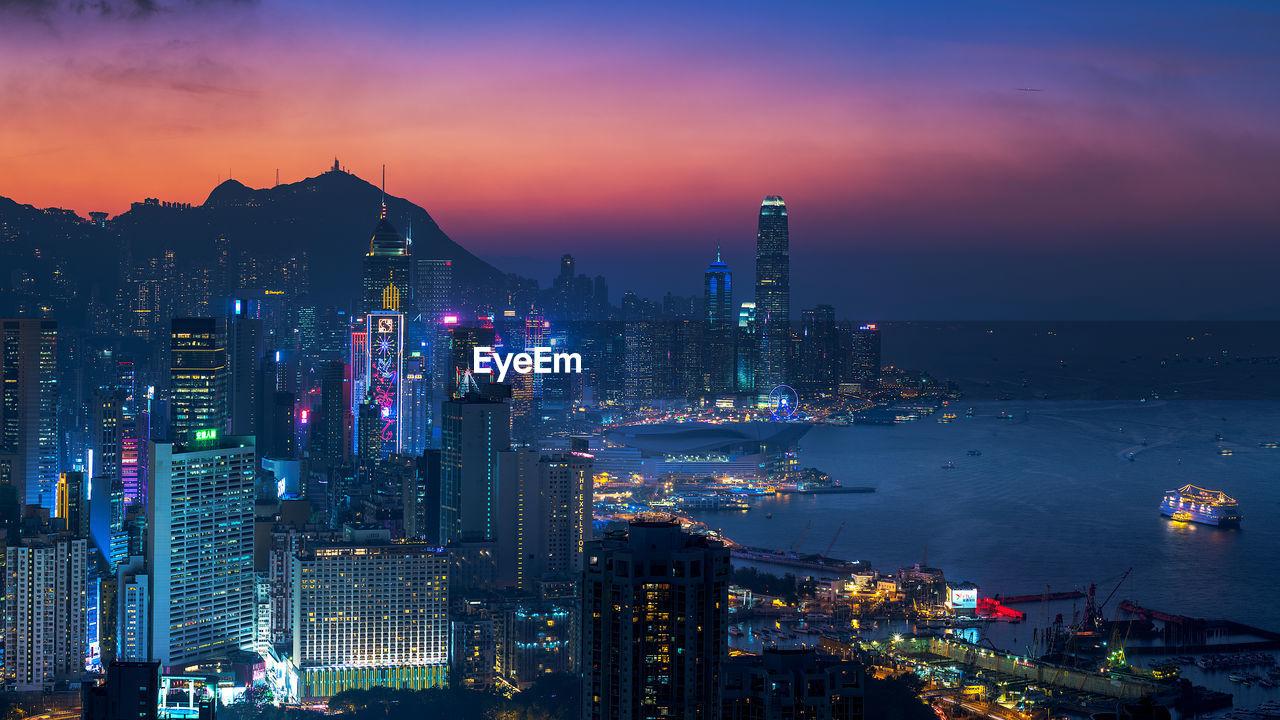 Illuminated View Of Hong Kong Against Sky At Sunset