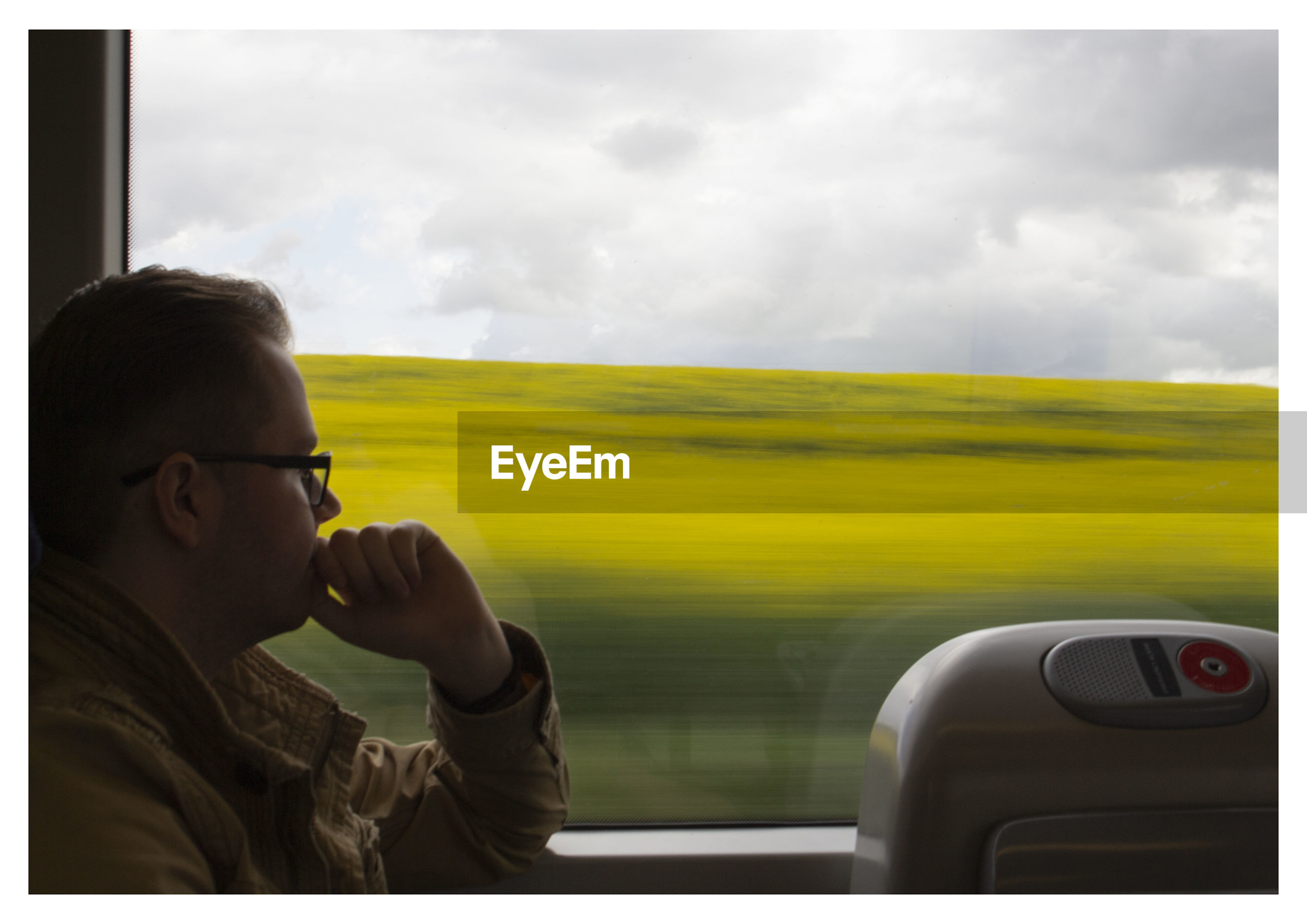 Portrait of man in train against sky
