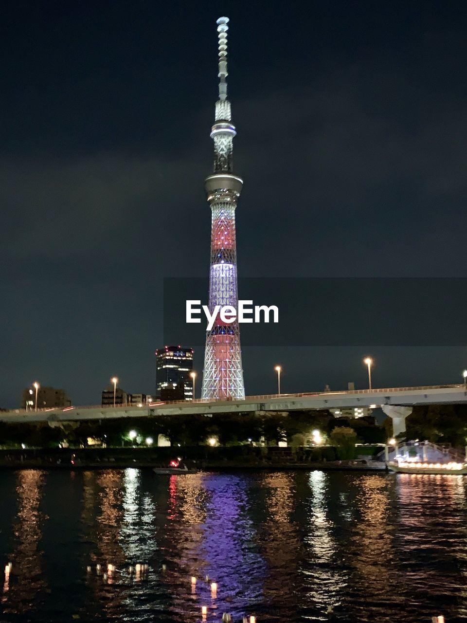 VIEW OF ILLUMINATED TOWER BRIDGE AT NIGHT